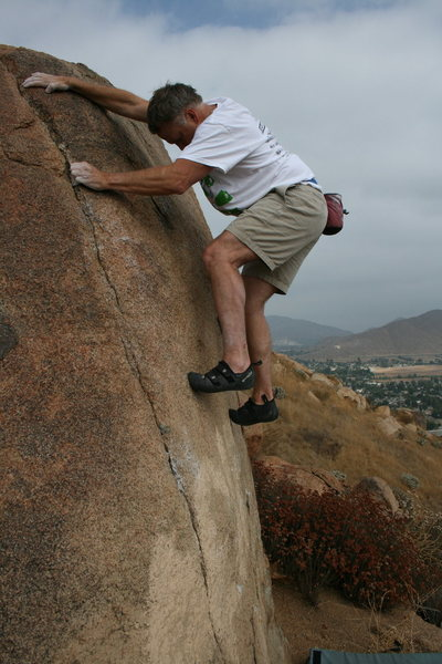 Kevin on the hardest problem on this boulder. Not much footing.