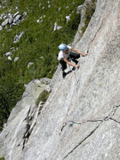 Rock Climbing Photo: Ursi traverses to finger crack in pitch 3