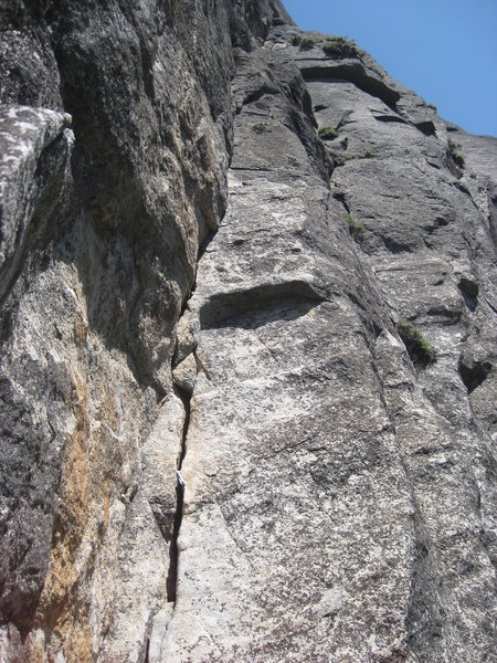 A look at the good quality of pitch three and the rarely climbed upper top-out pitches (5.9)