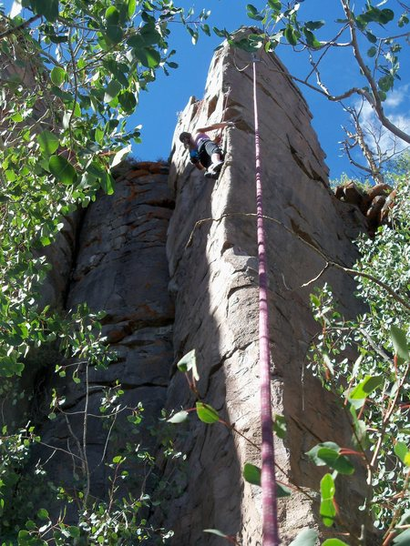 Contemplating the crux moves to reach the anchor.