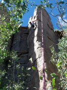 Rock Climbing Photo: Contemplating the crux moves to reach the anchor.