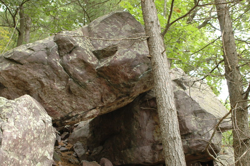 Another random boulder in the woods to the east of The Jewel.  Possibly a cool little powerful boulder problem.
