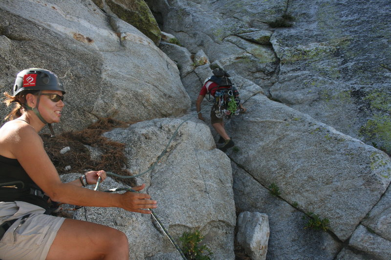Nathan starting up the first pitch with Agina on belay.