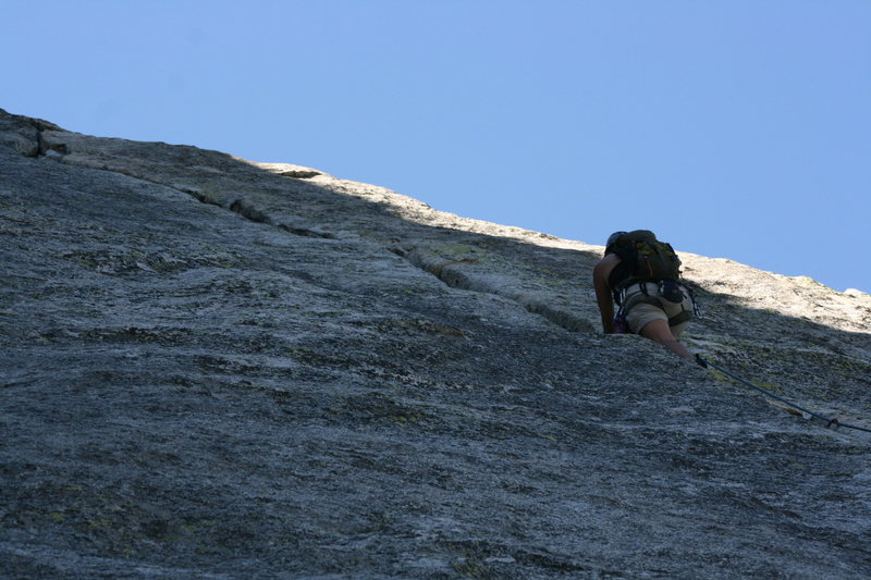 Agina into the fun crack climbing of pitch two.