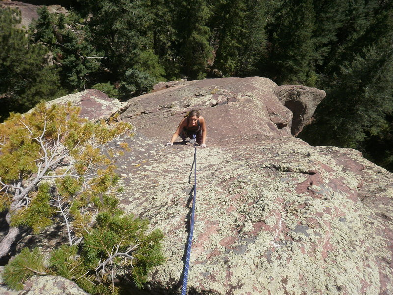 Looking down on the crux.  Move right under the little tree. I belayed here to keep the rope from damaging the tree....