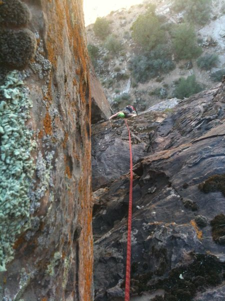 Erin pulling through crux on p. 2