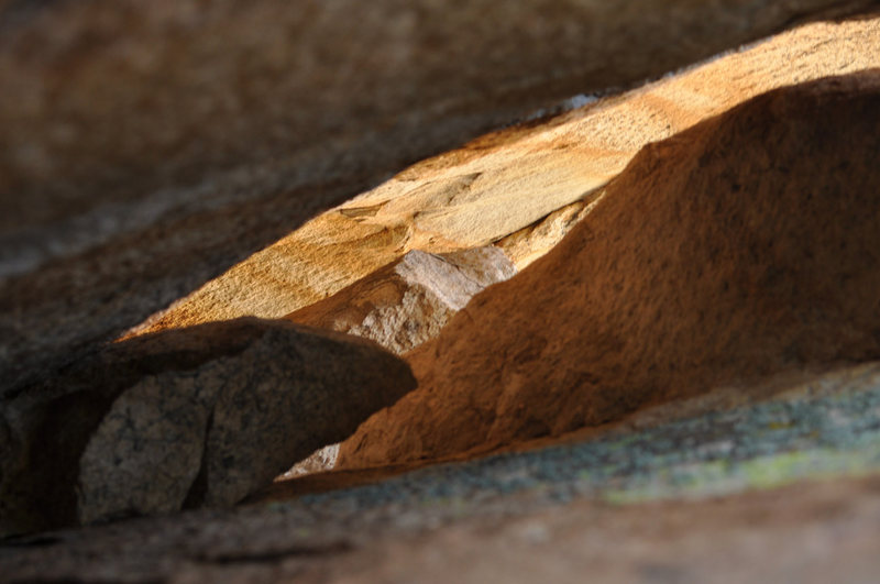Rock Climbing Photo: Looking through a crack in Bl'iever Boulder