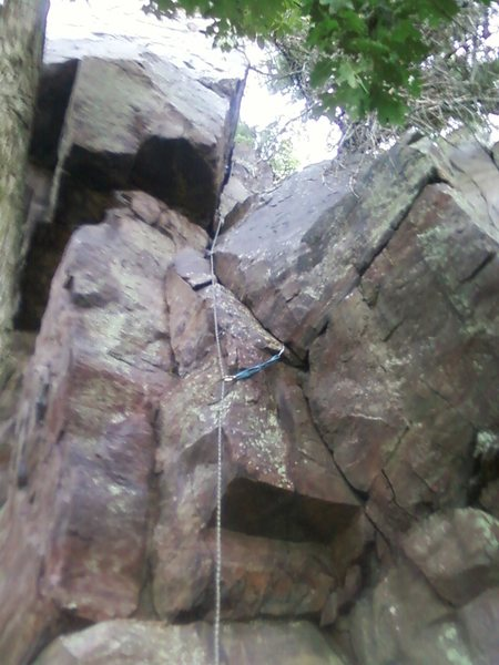 Follow the rope line. I led it and finished on the south face. The west face has no pro but is a good TR.