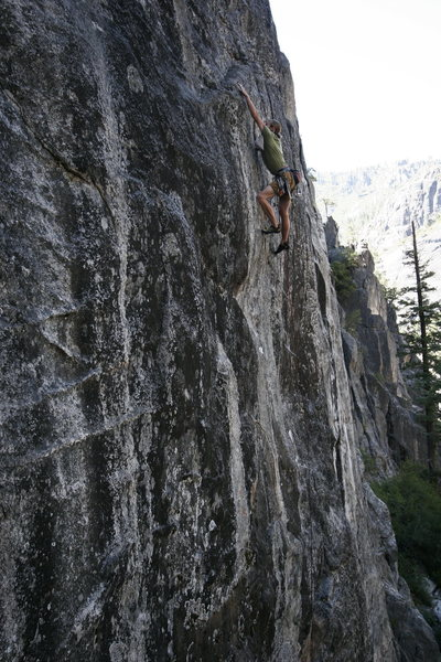 Working the (only) good finger lock down and going for the sloping shelf at the end of the crux sequence on &#39;The Audacity of Rope&#39; (13b).<br> photo by S. Giffin