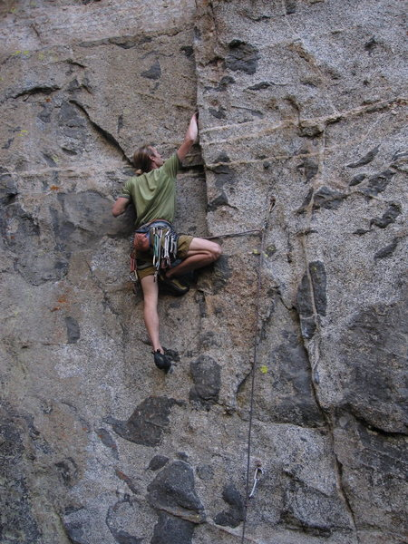 Working up into the initial tips crack section on 'The Dream', a great 12c.<br> photo by S. Davis