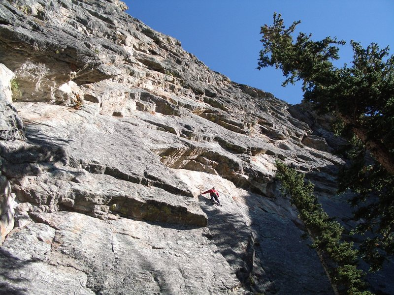 Moving up on the steepening ramp below the roof - enjoying that sunshine on a cool September day!