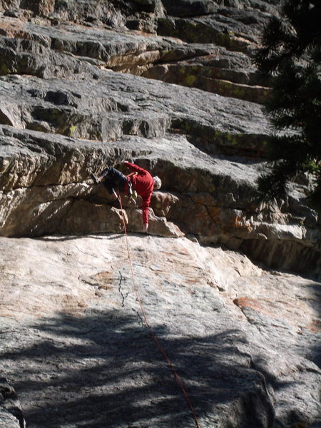 Bob Siegrist engaged in the crux sequence during the first ascent.