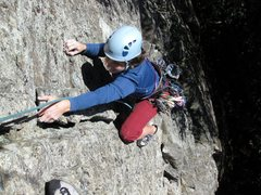 Rock Climbing Photo: Diane topping out above the horn.