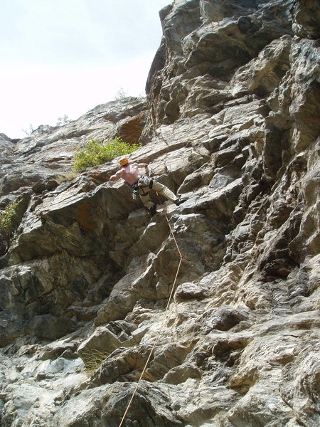 Paavo Thabit reaching left at the P1 crux. P2 ascends the buttress up and right of Paavo.
