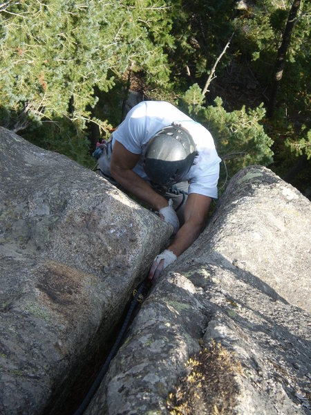 Jonathan surmounting the pain of a bloodied thumb incurred on the sport climb to the left.
