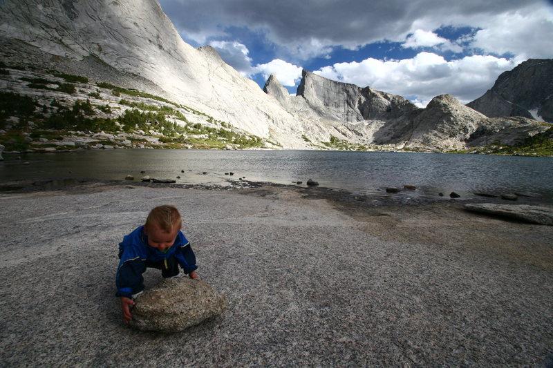 Axel gets ready to throw a rock into Deep Lake.
