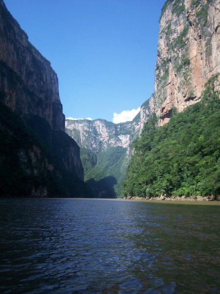 Classic view of The Sumidero Canyon taken by boat. This vantage point of the canyon is used for the state seal and official state flag of Chiapas.