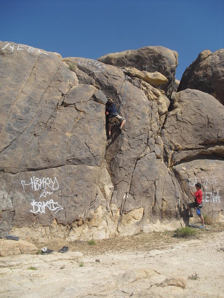 Carlo Rivas climbing Mickey's Easy Corner(5.3 variatoin) on TR, Ghost Boulders, Johnson Valley Area.