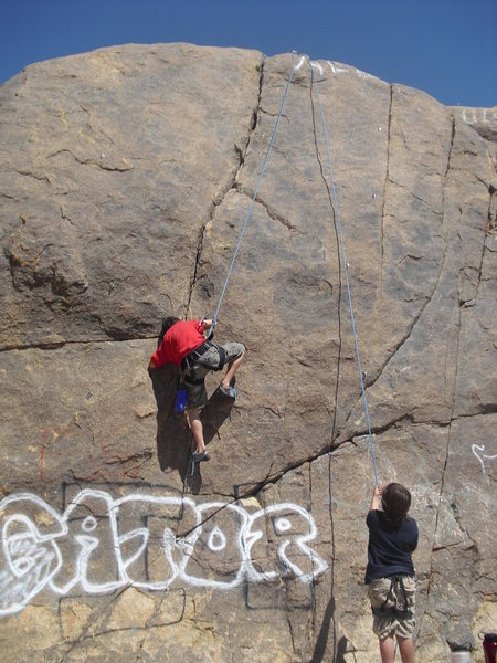 Mitchell Boreing climbing Thin Crack on TR, Ghost Boulders, Johnson Valley Area.