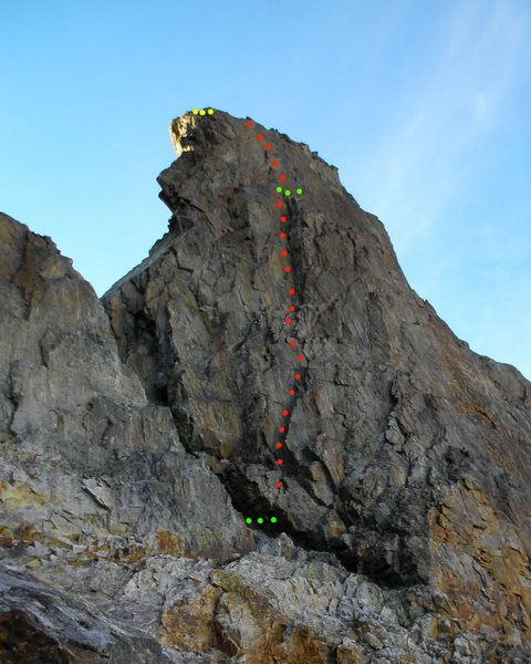 Our route up the grand chimney of Treasure Mountain. Pretty good rock. Descent belay ledge but not that much gear at the ledge. 5.8+ climbing. Green marks the belays, yellow marks our anchor we left to rap off, two old pitons and a tri-cam equalized with webbing and a locker.