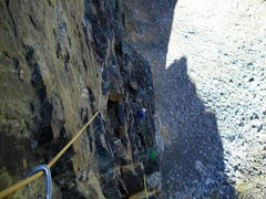 Lookin' down on rog mid way up the second pitch. Rog is belaying from the ledge about a couple hundred off the deck. The gear is good, if the rock is good, but the rock is questionable in places.