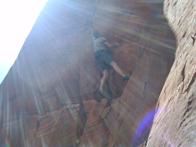 Matt going after Red Planet (5.13b), beautiful ringlocks to fingers