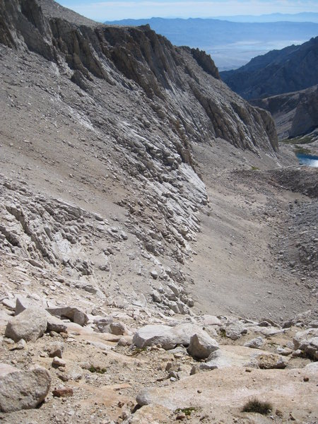 """The use tail and scree slope below the south face.  Taken from the """"L Shaped Pass""""."""