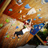 Whitney climbing on the wall during a recent friendly competition I threw.<br> <br> All of the problems were individually taped and there were &quot;Bonus&quot; holds which are the Smith Stickers.