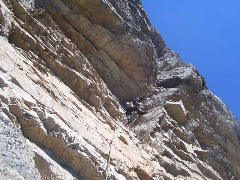 Tristan moving up to the rest before the hard crux of pitch 14. This was the high point on our FA attempt.