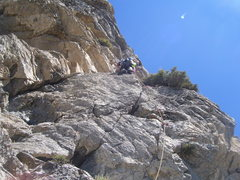 Just after the tough steep finger crack start to 13. One of the cruxes of the whole route is just above him.