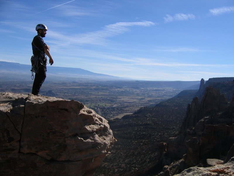 Top of Bottle Top Tower with all of Grand Junction and the rim of the Monument in the distance.