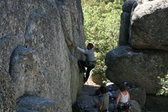 Rock Climbing Photo: Ray getting started on Velociraptor 5.10a.