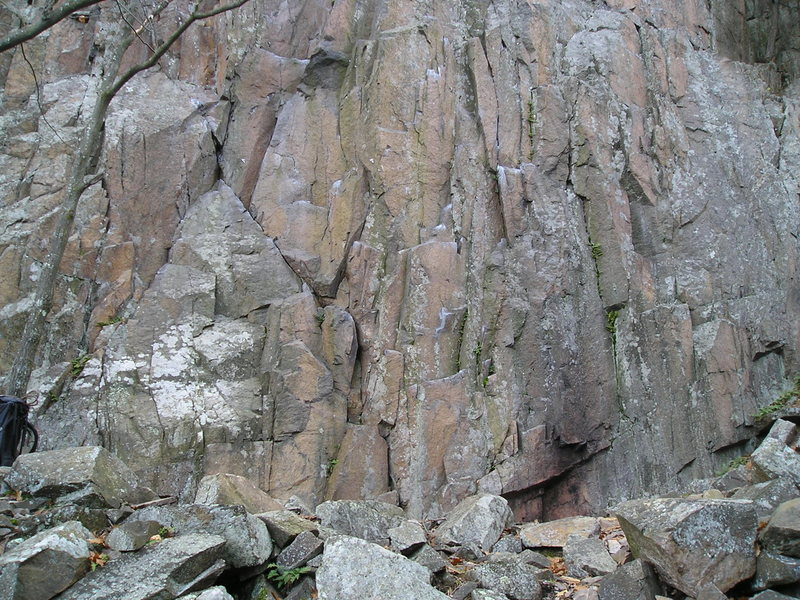 """Start of 5.10D, crux is 20 feet up. Starts immediately on right side base of the 10-A """"triangle"""", has seperate bolts."""
