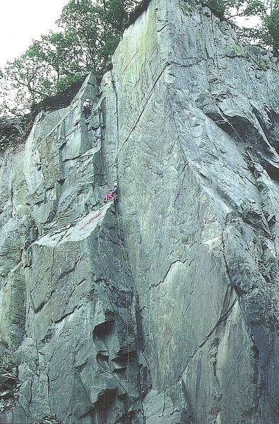 Paul Ross on P2 the first ascent .The knife edge on the right is the Titanic Arete. Photo Tony Greenbank.