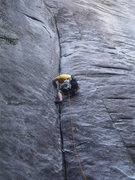 Rock Climbing Photo: The tough slab section of P1