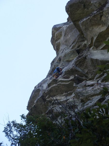 Ship Rock, Hindu Kush, Carl at 1st belay-standing on crux roof.