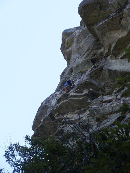Ship Rock, Hindu Kush, Carl at 1st belay-standing on crux roof.