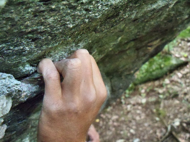 """Steve's tendons working hard on """"Casual Tees"""" (V6) on the A.V.P. Boulder."""