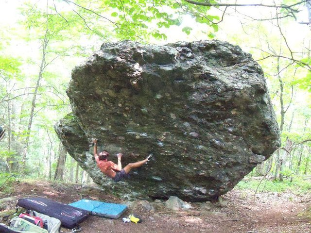 "Steve working ""Casual Tees"" (V6) on the A.V.P. boulder."