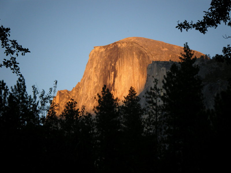 Sunset on Half Dome as seen from Currey Village parking lot.