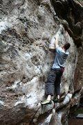 Rock Climbing Photo: Jonny moving up the flake on Bad Company