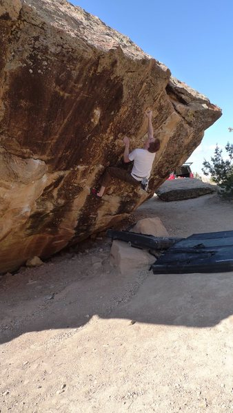 Setting up for the short crux of Route 4, V4 on the Right Gonad.