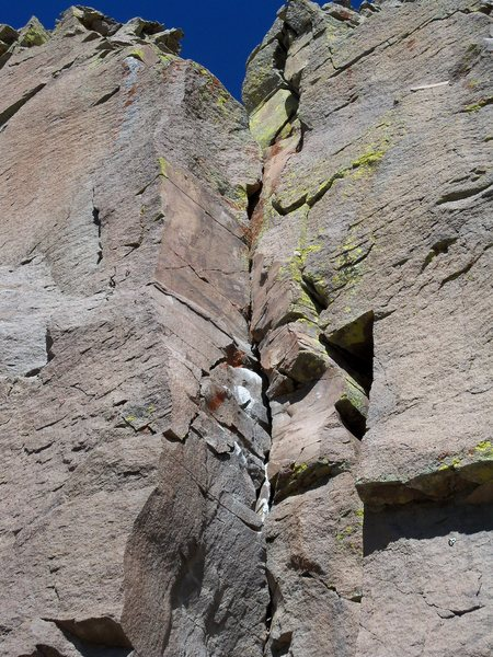 After passing the three bolts left of the arete, move into the obvious right-facing dihedral and crack system.