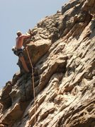 Rock Climbing Photo: Cory Brewster topping out Oyster.