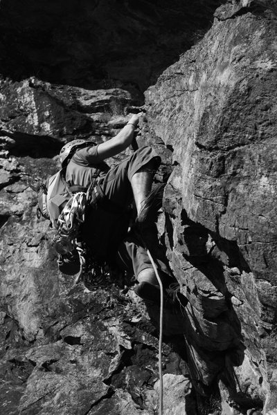 Rock Climbing Photo: Dan C on the start and crux of pitch 3, SE corner....