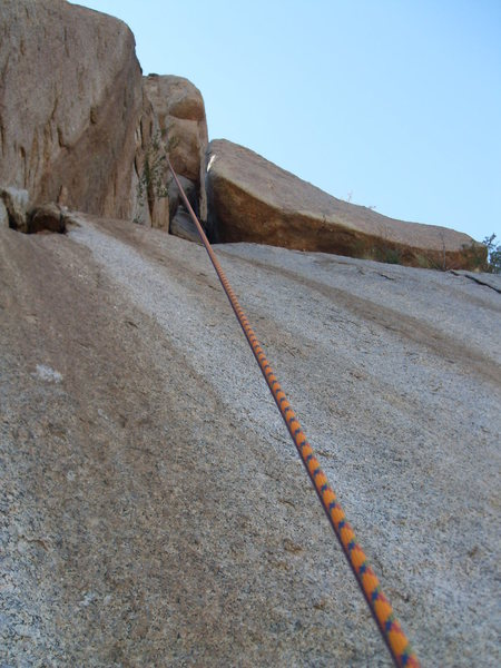 Word to the wise! The giant block, seen behind the rappel rope, is challenging to protect, tricky to climb, and rates much higher than 5.4 in my book.