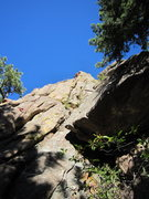 Rock Climbing Photo: Tim Davis leads up the long, blunt arete of Spire-...