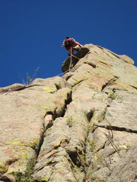 Rock Climbing Photo: Tim Davis slaps the crux moves (5.10a) on Spire-A-...
