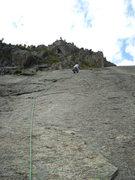 Rock Climbing Photo: Drilling on P2