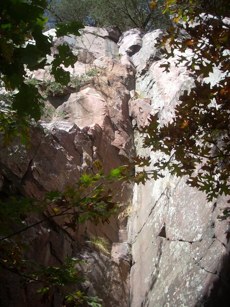 The inside corner is &quot;Close Call&quot; 5.6.<br> The left wall is &quot;Magellanic Cloud&quot; 5.11d which joins &quot;Buddha&quot; at the ledge. On the right is &quot;Prayer Flag&quot; 5.7 which joins &quot;Close Call&quot; at halfway.